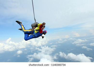 Skydiving, tandem jump. Indian man is flying in the sky.