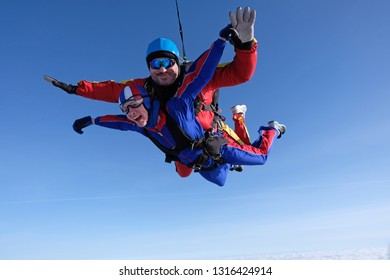 Skydiving. Tandem jump of man and girl.