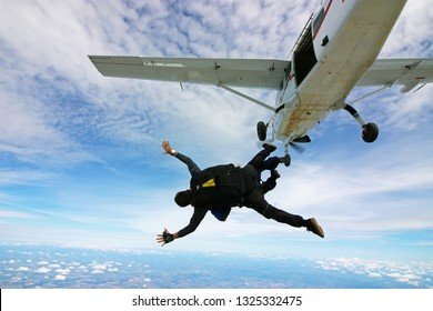 Skydiving tandem jump out of plane