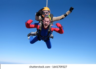 Skydiving. Tandem jump. Two men are flying in the sky.