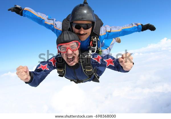 Skydiving. Tandem passenger is very happy.