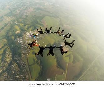 Skydiving teamwork concept vintage color