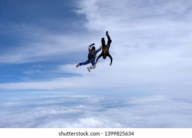 Skydiving. Two men are in the sky.