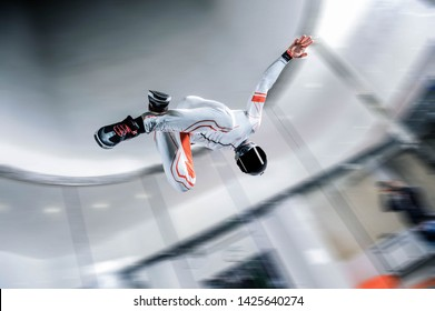 Skydiving.I flying in wind tunnel. Indoor skydiving. Training in wind tunnel. New  sport in flight technology. Flying in fast wind