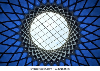 A skylight in a geodesic roof structure made of steel and blue glass