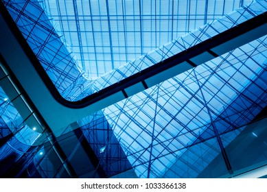 Skylight Glass Roof or Ceiling with Geometric Structure in Modern Contemporary Architecture Style. Modern blue tone background.