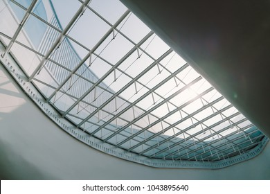 Skylight or glass sunroof ceiling of a building. Modern design architecture, or energy conservation model using nature sunlight concept