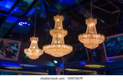 Skylight and luxury chandeliers in restaurant interior