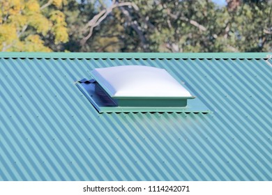 Skylight on green metal roof