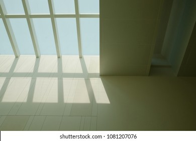 skylight window performs shadow onto the wall of the museum during the daytime