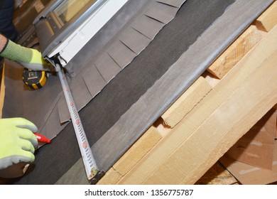 Skylight window waterproofing installation details on house rooftop. Roofer installing skylight window on the roof top with waterproofing membrane.