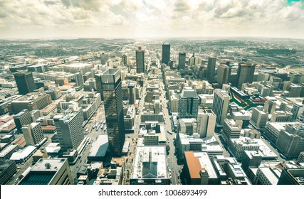 Skyline aerial view of skyscrapers in business district of Johannesburg - Architecture concept with modern buildings of skyline in South Africa biggest city with southafrican flag painted on walls