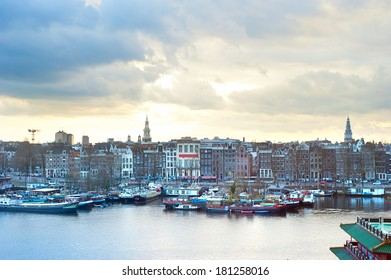 Skyline of Amsterdam at colorful dusk. Aerial view