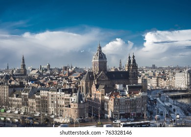 Skyline Amsterdam, The Netherlands, with basilica (church) Saint Nicolas and beautiful sky.