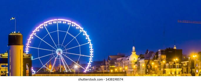 skyline of antwerp city with the ferris wheel lighted at night, Antwerpen, Belgium