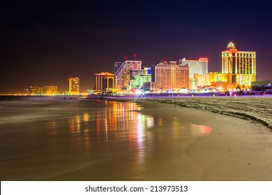 The skyline and Atlantic Ocean at night in Atlantic City, New Jersey.