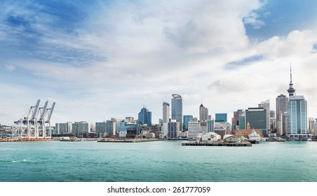 skyline of Auckland with city central business district and port cranes at cloudy noon