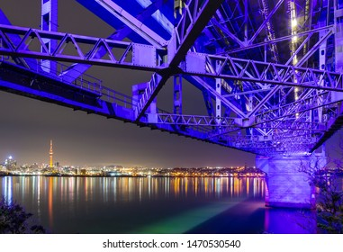 The Skyline of Auckland, New Zealand, at Night, Viewed From Beneath the Auckland Harbour Bridge