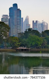 Skyline of Bangkok, Thailand from the heart of the city, Lumpini Park.