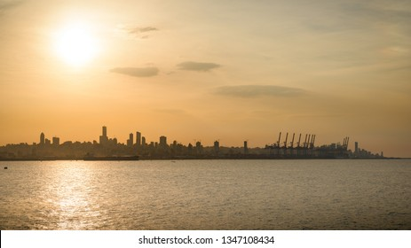 Skyline of Beirut and its port over Antelias bay and the Mediterranean sea, at sunset.