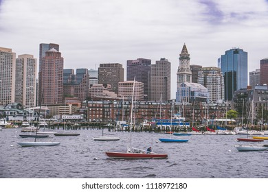 Skyline of Boston (Massachusetts) with boats alined at the front. Picture taken on a ferry back to downtown Boston after walking the freedom trail