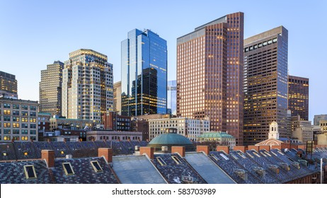 The skyline of Boston in Massachusetts, USA showcasing its mix of contemporary and historic architecture at sunrise.