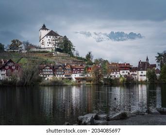 Skyline of Buchs with Werdenberg Castle, Werdenberg Lake and Alps Mountains on background - Buchs, Switzerland