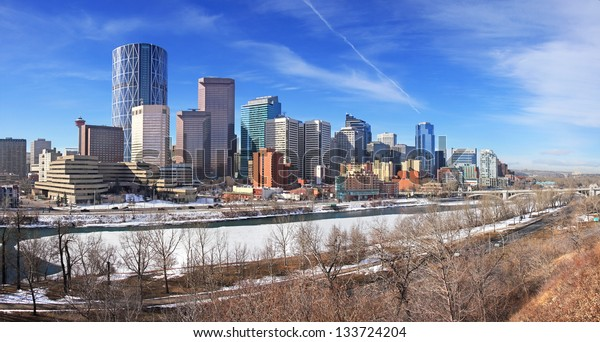 Skyline of Calgary, Alberta, Canada. Bow River partly covered with Snow and Ice. Picture taken March 1, 2013