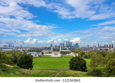 Skyline of the Canary Wharf business district of London. The Royal Naval College is in the foreground. Photo taken from the top of the hill at Greenwich park.