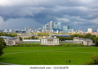Skyline of the Canary Wharf business district of London. The foreground features the Royal Naval College.