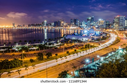 Skyline of capital city Luanda, Luanda bay and seaside promenade with highway during afternoon, Angola, Africa