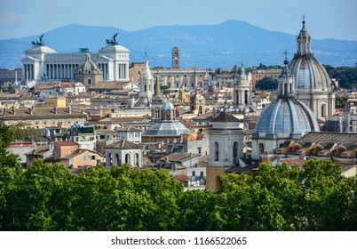 Skyline of central Rome, Italy, from Castel Sant'Angelo with Colosseo, Vittoriano monument, Capitoline Hill and domes of Roman churches (Il Gesu, Sant'Agnese in Agone, San Salvatore in Lauro)