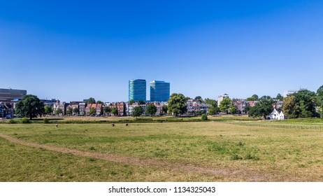 Skyline of city  Arnhem, Netherlands, with Park Sonsbeek in the foreground.