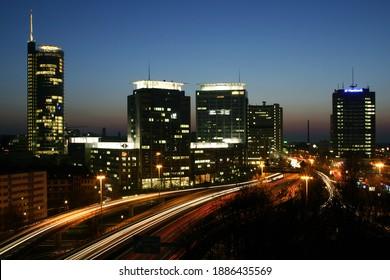 skyline city essen NRW germany 02.06.2005 blue hour headlights at night highway light streaks long exposure metropole nrw tower landscape town sky A40