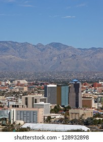 Skyline of the city of Tucson, Arizona showing the Catalina mountains and beautiful blue sky in the background