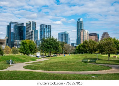Skyline Cityscape Downtown view with modern Green Space at Sam Hill Park with amazing Tall Glass Towers rising above the Colorado River and Texas Hill Country City landscape