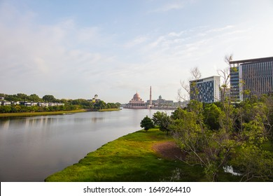 The skyline or cityscape of the Malaysian government city Putrajaya. in the background the Putrajaya mosque and the Putra lake. In the foreground one of many parks in Putrajaya, Malaysia.