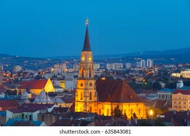 Skyline of Cluj-Napoca with the church of Saint Michael at twilight. Romania