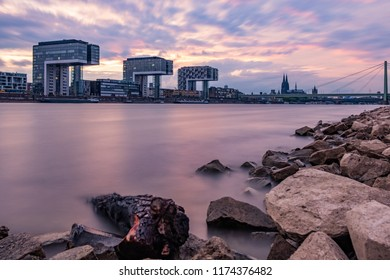 Skyline Cologne during Sunset with Lila Clouds - The Kranhäuser, the Cologne cathedral an the Severins bridge in front of the Rhine