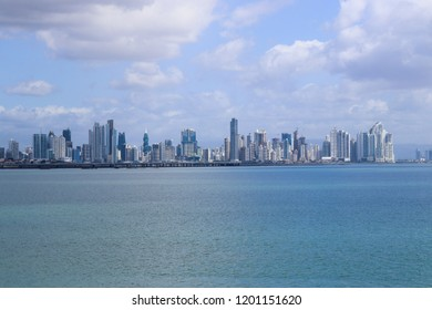 Skyline in distance with gulf front on cloudy day; cityscape background with copy space