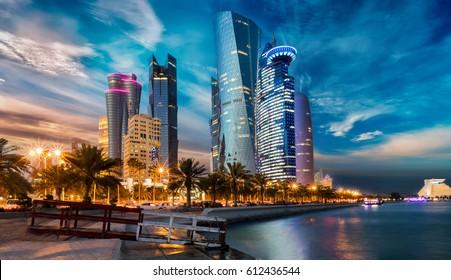 The skyline of Doha city center after sunset, Qatar