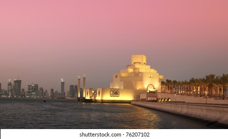 The skyline of Doha, Qatar, and the Museum of Islamic Art at sunset, filtered.