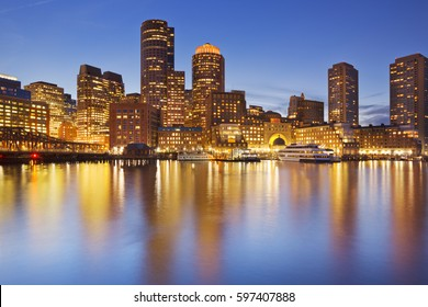 The skyline of downtown Boston, Massachusetts from across the water at dusk.