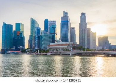 Skyline of Downtown Core of Singapore by the river at sunset