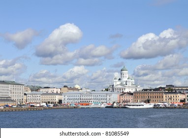 Skyline of downtown Helsinki in the summer, seen from the South Harbor (Etelasatama). Helsinki Cathedral seen towering above the surrounding neoclassical buildings. Market square in the foreground.