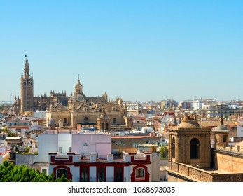The skyline of downtown Seville, beautiful view of the El Divino Salvador Church and Catedral de Sevilla
