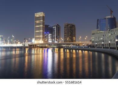 Skyline of Dubai Business Bay illuminated at night. United Arab Emirates, Middle East
