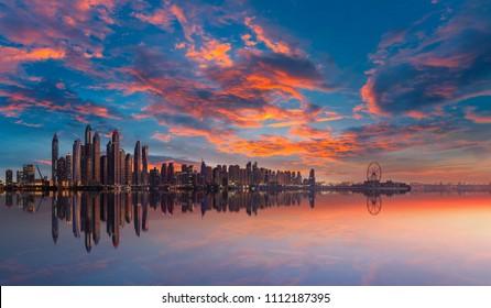 Skyline of Dubai Marina at a beautiful sunset with dramatic sky