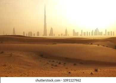 Skyline of Dubai at sunset or dusk, view from Arabian Desert