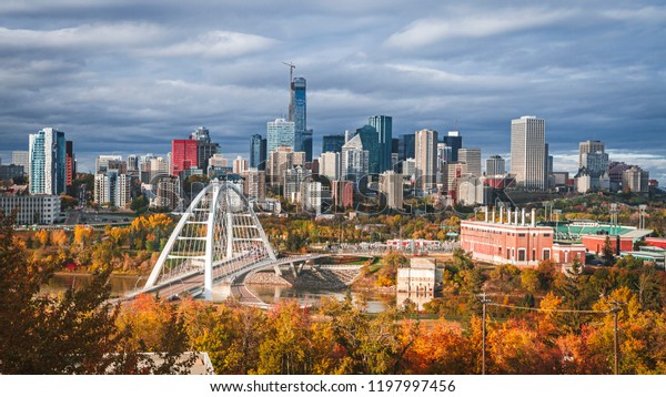 Skyline of Edmonton - capital of Alberta, the oil city, on North Saskatchewan River during colourful, vivid autumn, fall. Sunny day, panorama layout.